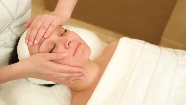 Masseuse Massaging Female Client: Stock Video