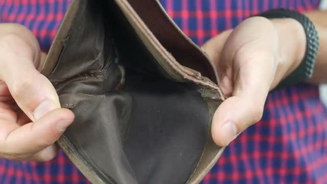 Man Showing Empty Wallet: Stock Video