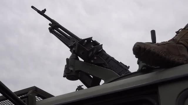 Soldier Rotating Gun Turret on Vehicle: Stock Video