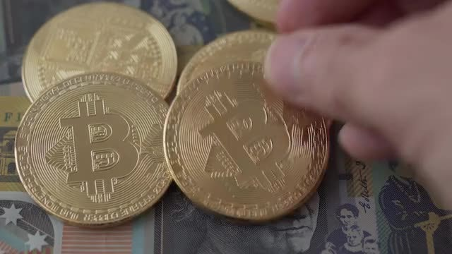 Hand Picking And Replacing Bitcoin: Stock Video