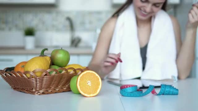 Woman Using Tablet In Kitchen: Stock Video