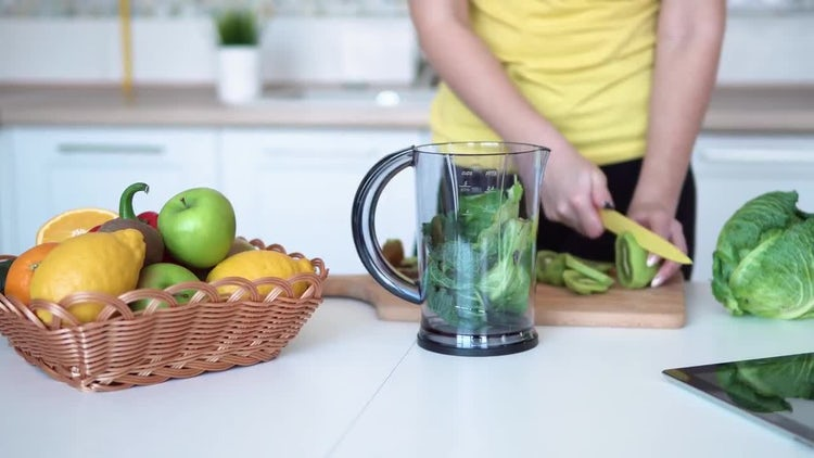 Girl Slicing Up Kiwi Fruit: Stock Video