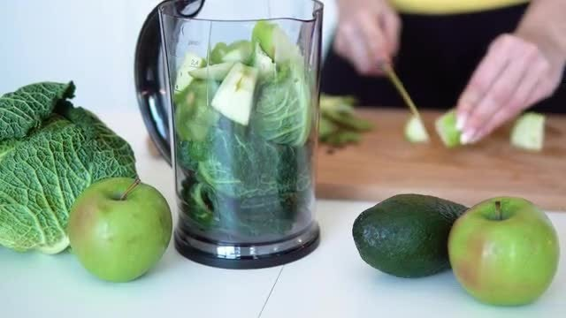 Woman Slicing Apple For Smoothie: Stock Video