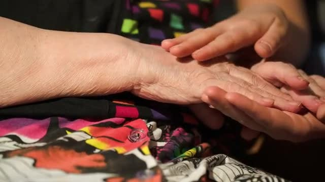 Girl Stroking Her Grandmother's Hands: Stock Video