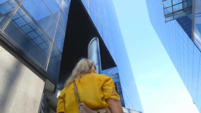 W0man Walking Into Highrise Building: Stock Video