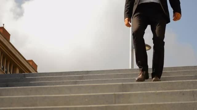 Businessman Walking Down The Stairs: Stock Video
