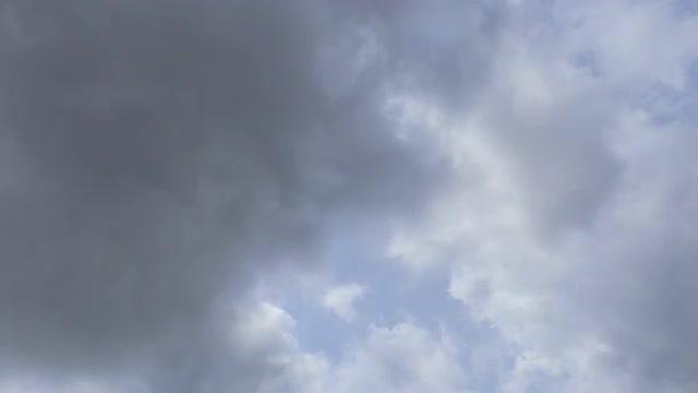 Storm Clouds Darken Bright Sky: Stock Video
