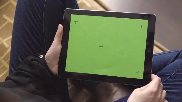 Holding Tablet While Sitting Cross-Legged: Stock Video