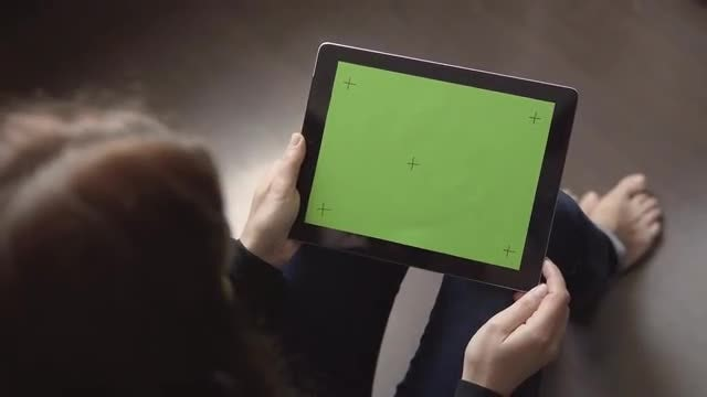 Using Tablet  On The Floor: Stock Video