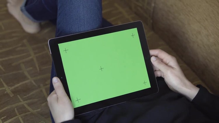 Girl On Sofa Uses Tablet: Stock Video
