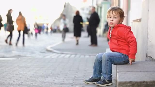 Small Boy Sitting Alone Outdoors: Stock Video