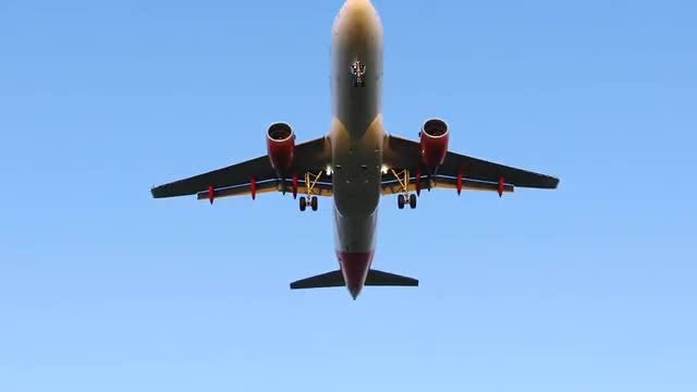 Low-angle Shot An Airplane Flying: Stock Video