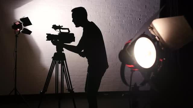 Cameraman Working In Film Studio: Stock Video