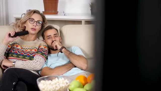 Couple On Couch Spending Time: Stock Video