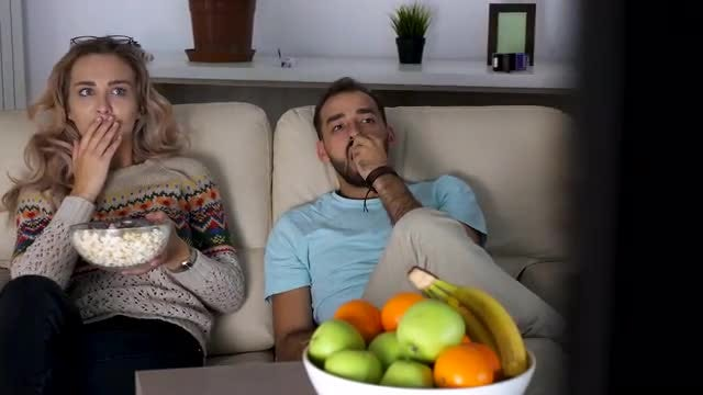 Young Couple Watching Horror Movie: Stock Video