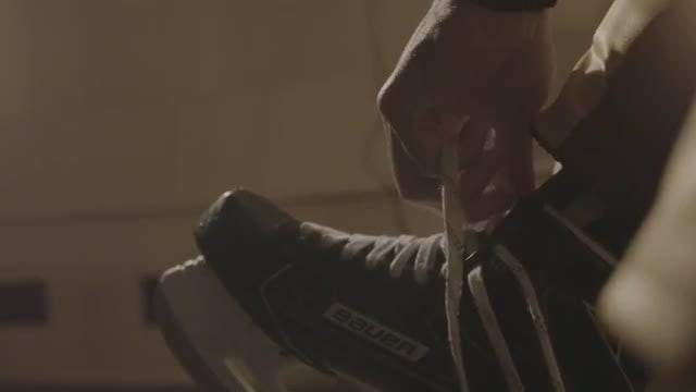 Ice Hockey Player Lacing Skates: Stock Video