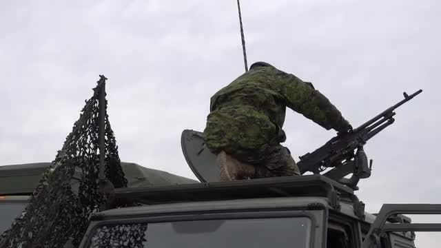Soldier Adjusts Gun Turret: Stock Video