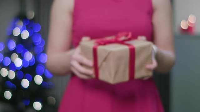 Woman Handing Over Gift Box: Stock Video