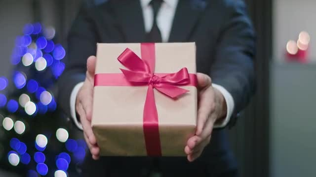 Man Handing Gift: Stock Video