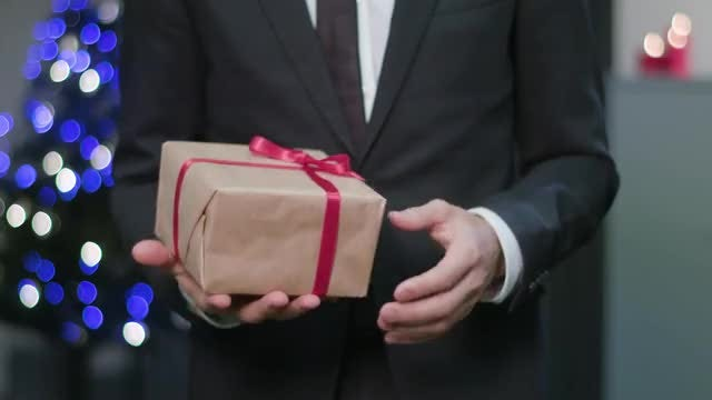 Man Playing With Gift Box: Stock Video