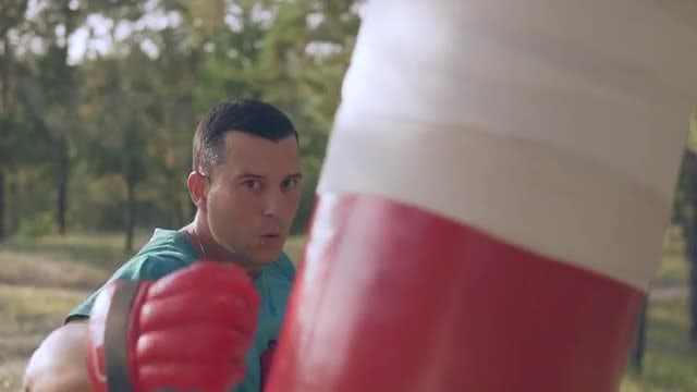 Boxer Training With Boxing Bag: Stock Video