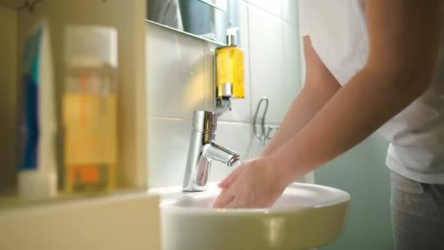 Woman In Bathroom Washing Hands: Stock Video