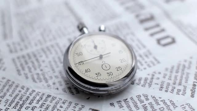 Watch On A Newspaper: Stock Video