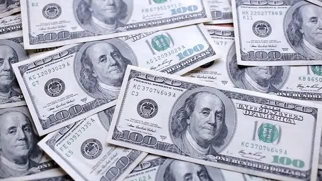 Panning Shot Of Dollar Bills: Stock Video