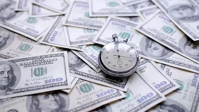 Stopwatch On Dollar Bills: Stock Video