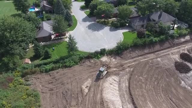 Construction Beside New Subdivision: Stock Video