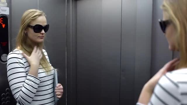 Woman Primping In The Lift: Stock Video