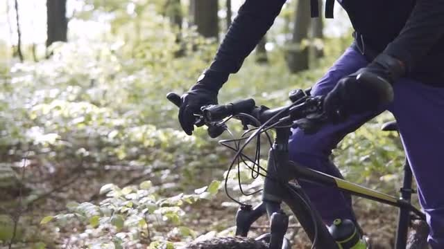 Male Biker In The Forest: Stock Video