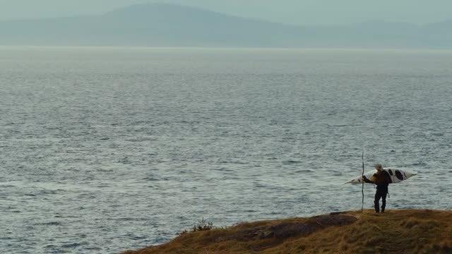 Female Kayaker Standing On Shore: Stock Video