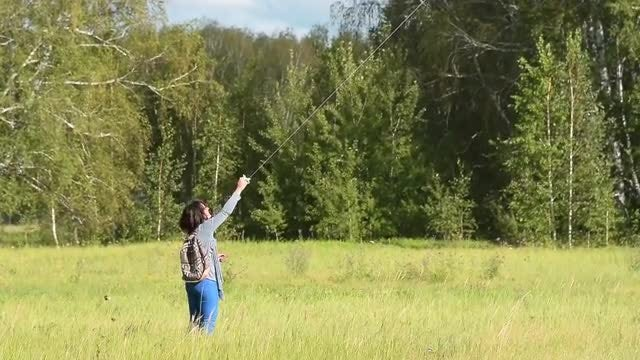 Woman Playing With A Kite: Stock Video
