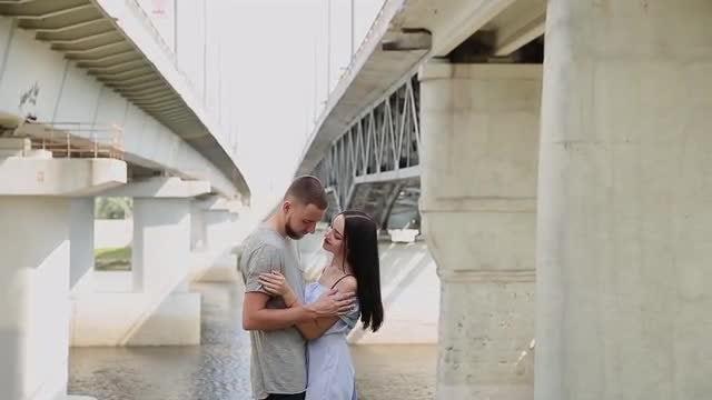 Lovers Embrace Under The Bridge: Stock Video