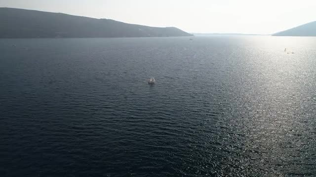 Boat Sailing Along Mesmerizing Seascape: Stock Video