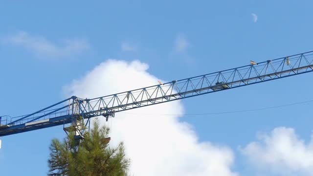Crane Sheave Against The Sky: Stock Video