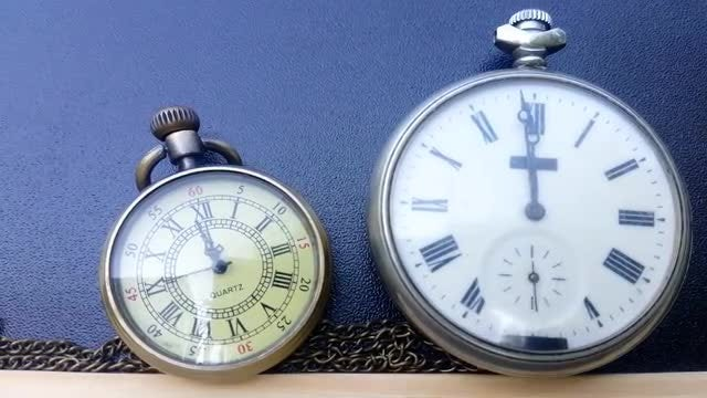 Two Pocket Watches Indicating Noon: Stock Video
