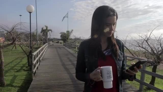 Woman Walking Along The Riverside: Stock Video