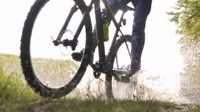 Man Rides Bicycle Through Puddle: Stock Video