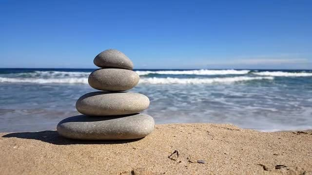 Stacked Zen Stones On Beach: Stock Video