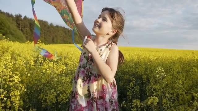 Girl Enjoys Running With Kite: Stock Video