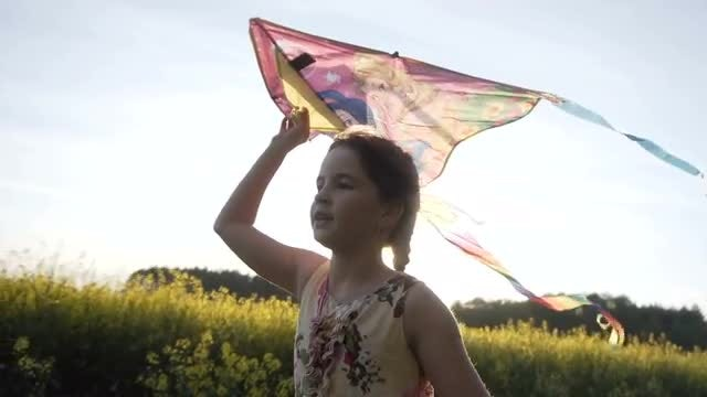 Cute Girl Flying Colorful Kite: Stock Video