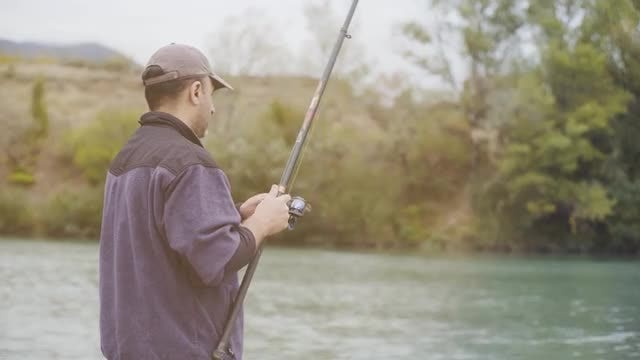 Man Fishing In The River: Stock Video