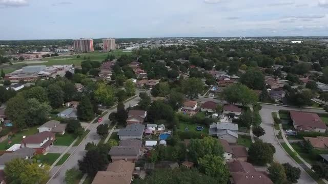 Flying over Vast Neighborhood with Apartments in Background: Stock Video