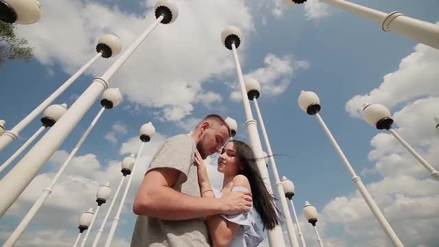 Loving Couple Caressing Under Street Lamps: Stock Video