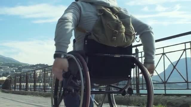Man Travelling On A Wheelchair: Stock Video
