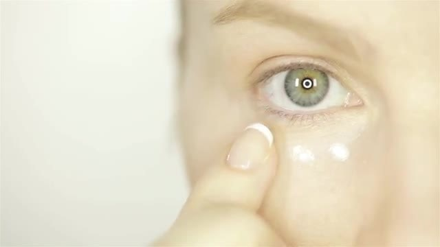 Woman Applying White Skin Cream: Stock Video