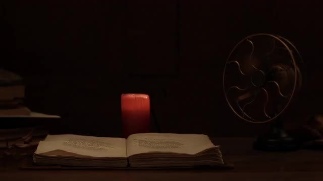 Mystery Book In Dark Room: Stock Video