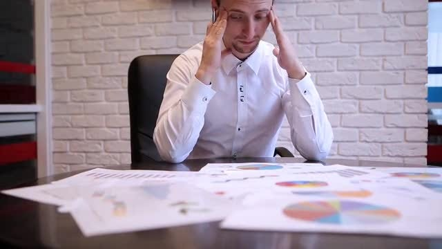 Businessman is Working In The Office: Stock Video